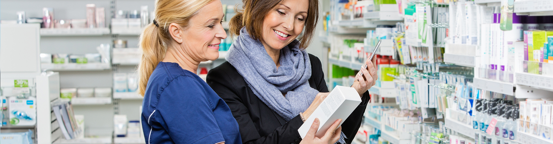 pharmacist helping customer with medicines